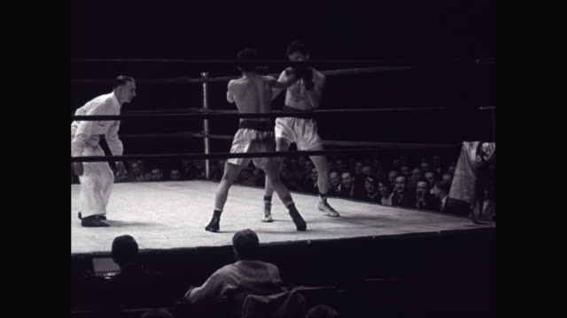 ws boxers fighting in box ring with referee / united states - ボクシングリング点の映像素材/bロール