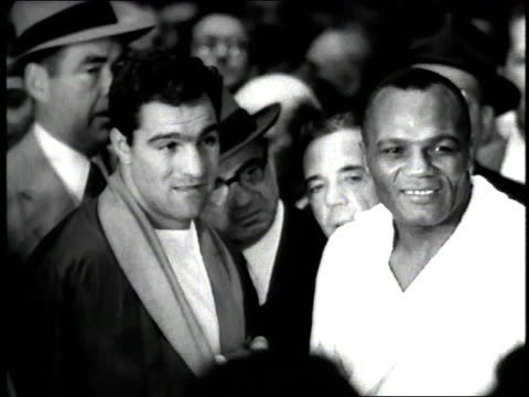boxers rocky marciano and jersey joe wolcott pose for photographers before the world heavyweight bout - heavyweight stock videos and b-roll footage