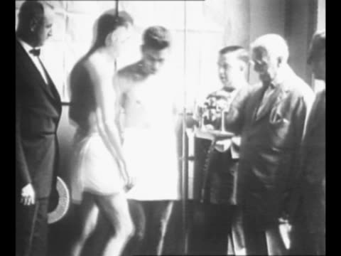 boxers tommy gibbons and gene tunney at weighin for the new york boxing commission before their boxing match gibbons weighs in first then tunney... - scales stock videos & royalty-free footage