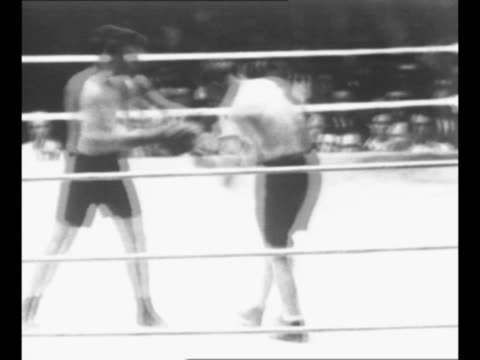 boxers tommy gibbons and gene tunney trade punches during their match at the polo grounds in new york city; vo crowd noise from here on / tunney... - newsreel stock videos & royalty-free footage