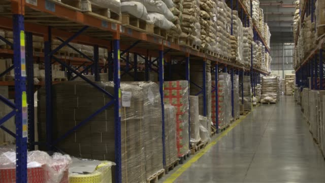Boxes and bags of tea in warehouse including Van Rees and Lipton Yellow Label at Dubai tea factory
