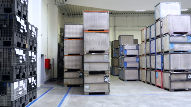 Boxes, containers with merchandise in storage room
