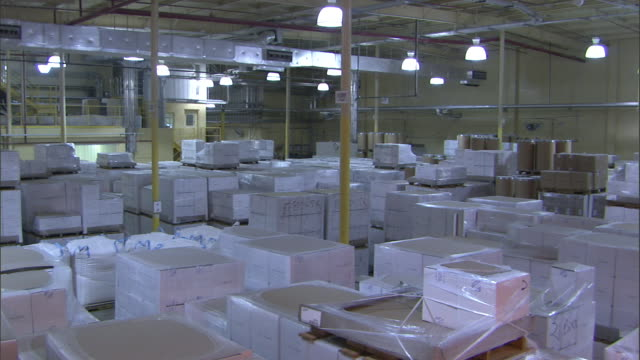 boxes fill a large warehouse. - compartment stock videos & royalty-free footage