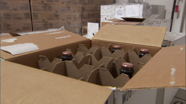 boxes of beer bottles fill a warehouse. - beer bottle stock videos & royalty-free footage