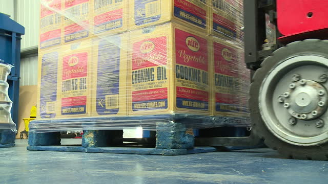 boxes of cooking oil being moved onto shelf in distribution warehouse, as it sees a record prices - land vehicle stock videos & royalty-free footage