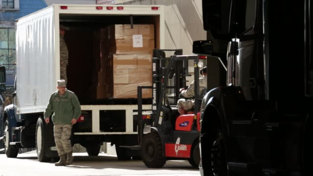boxes of holiday meal are loaded up to a truck for offsite distribution during an operation homefront event at the dc national guard armory - waffenlager stock-videos und b-roll-filmmaterial