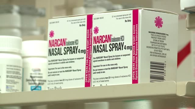 boxes of narcan, naloxone nasal spray, on shelves in chicago on september 19, 2016. - naloxone stock videos & royalty-free footage