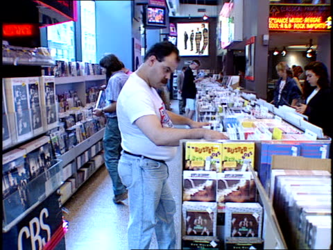 boxes of records and people in tower records browsing the shelves for music. - tower records stock videos & royalty-free footage