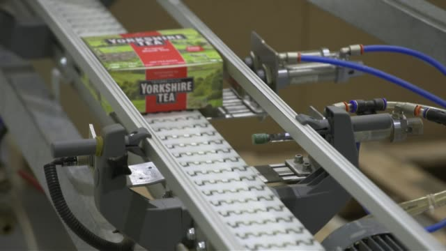 Boxes of Yorkshire Tea moving along production line in Dubai tea factory