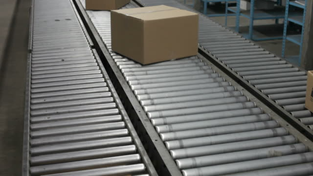 boxes on a conveyor belt - box container stock videos & royalty-free footage