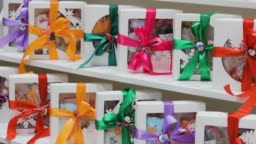 boxes with gifts on showcase .colored satin ribbon