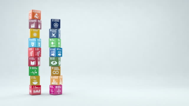 vídeos de stock e filmes b-roll de 3d boxes with sustainable development goals 2030 with copy space - fim