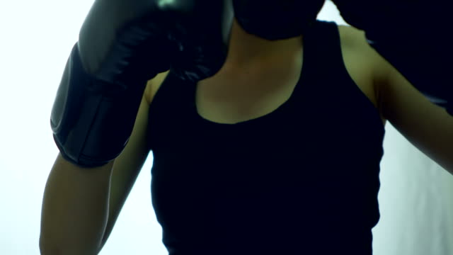 boxing gloves close up on boxing in the shadow - punch bag stock videos & royalty-free footage