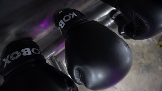 boxing gloves hang on the wall at kobox, london wall as the government has yet to announce the easing of restrictions for gyms on june 24, 2020 in... - boxing glove stock videos & royalty-free footage