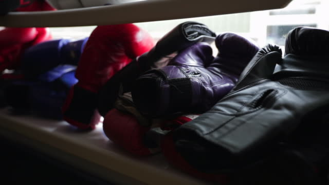 boxing gloves in a row - darlington north east england stock videos & royalty-free footage