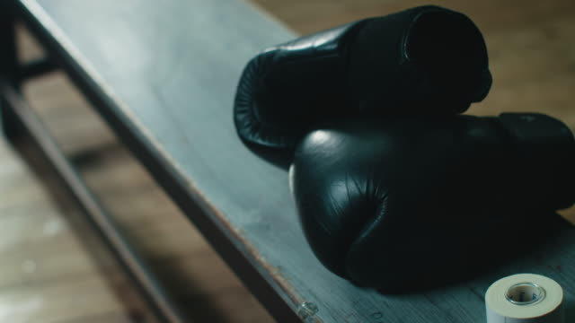 boxing gloves lying on bench - fighter stock videos & royalty-free footage