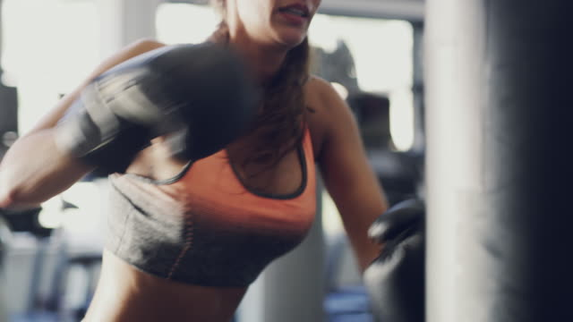 boxing is a surefire way to torch fat - muay thai stock videos and b-roll footage