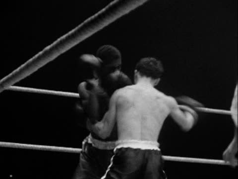 1950 MONTAGE B/W Boxing match and opponents congratulating one another at end of match/ Tulsa, Oklahoma, USA