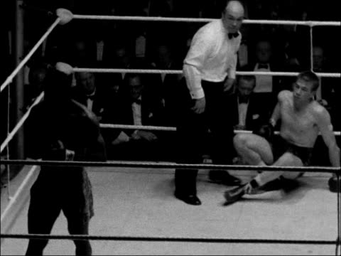 boxing match at the national sporting club england int boxers in centre of ring / dick tiger fighting johnny read / referee counting down tiger /... - boxing ring stock videos & royalty-free footage
