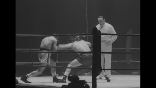 vídeos de stock e filmes b-roll de boxing match between us lightweight boxer paddy demarco and french lightweight champion seraphin ferrer in progress; seraphin knocks demarco to the... - lightweight