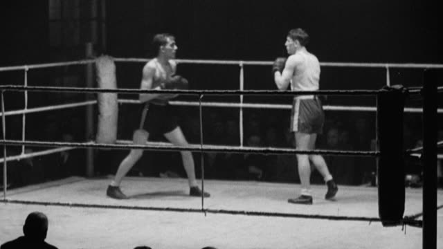 montage an.c.b. boxing match in the colliery canteen at doncaster, with eddy cadman and eric buxton throwing punches / grimesthorpe, england, united kingdom - boxa bildbanksvideor och videomaterial från bakom kulisserna