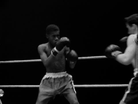 1950 montage b/w boxing match/ tulsa, oklahoma, usa - fist stock videos & royalty-free footage