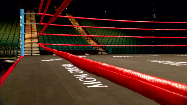 boxing ringside w/ ropes fg arena seating bg mgm grand painted on ring floor mat - ボクシングリング点の映像素材/bロール