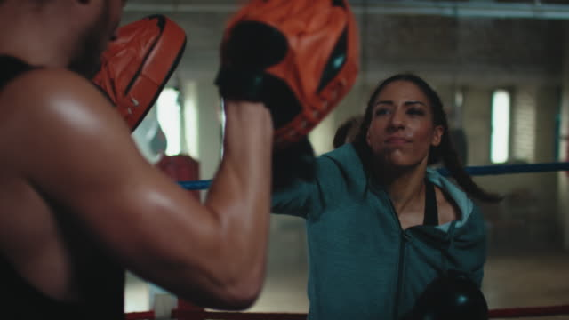 boxing trainer teaches woman - trainer stock videos & royalty-free footage