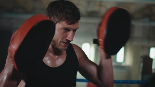 boxing trainer teaches woman - strength stock videos & royalty-free footage