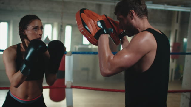 boxing trainer teaches woman - boxing ring stock videos & royalty-free footage