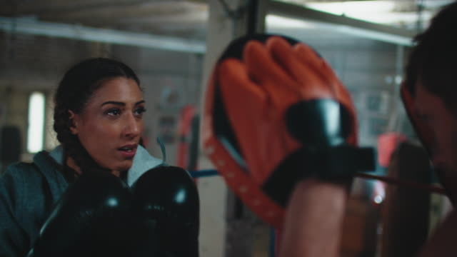 boxing trainer teaches woman - comment box stock videos & royalty-free footage