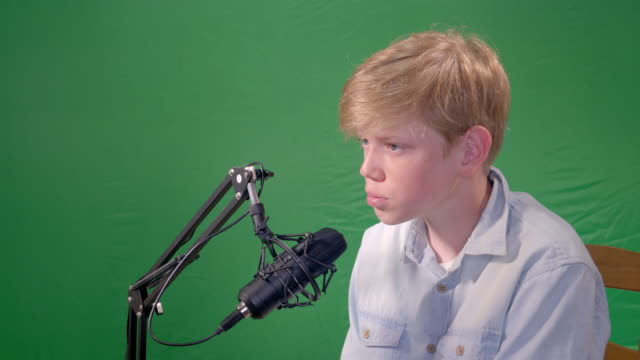 boy 12 years old is recording track bits in sound recording studio with green chroma-key on background. - solo performance stock videos and b-roll footage