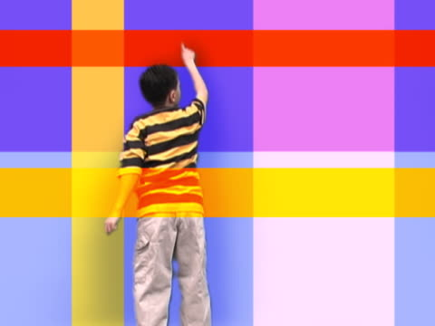 boy activating wall - saturated colour stock videos & royalty-free footage