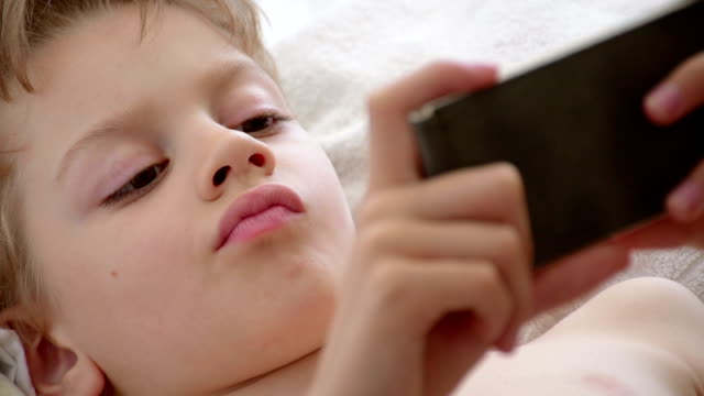 boy addicted to phone games - only boys stock videos and b-roll footage