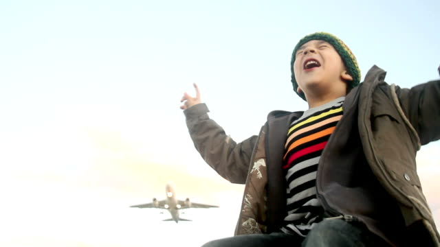 boy and airplane takeoff