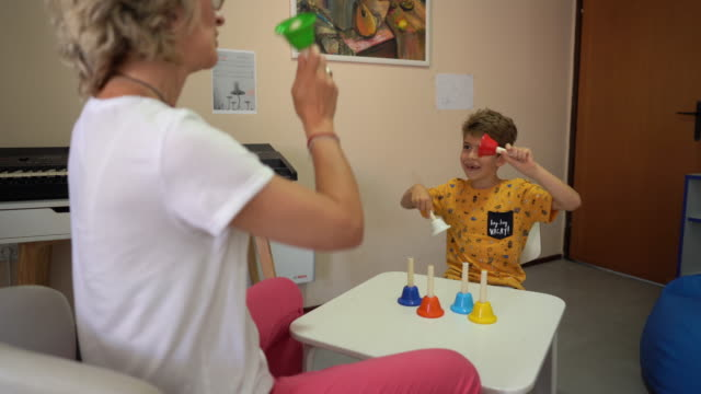 boy and doctor having fun during occupational therapy session at rehabilitation center - invisible disability stock videos & royalty-free footage