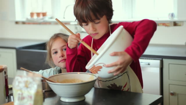 cu focusing boy (8-9) and girl (6-7) baking, yarmouth, maine, usa - baking stock videos and b-roll footage
