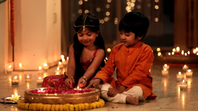 boy and girl celebrating diwali festival in the home, delhi, india - votive candle stock videos and b-roll footage