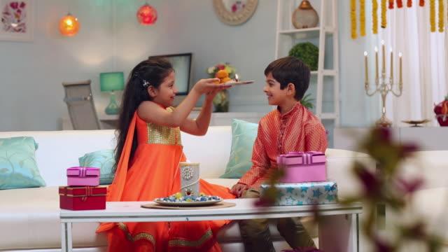 Boy and girl celebrating Raksha Bandhan festival