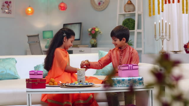 Boy and girl celebrating Raksha Bandhan festival