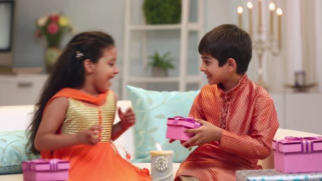 boy and girl celebrating raksha bandhan festival - brother stock videos & royalty-free footage
