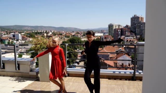boy and girl dancing latino dance on roof - salsa stock videos & royalty-free footage
