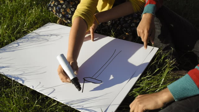 boy and girl drawing wind turbine - turbine stock videos & royalty-free footage