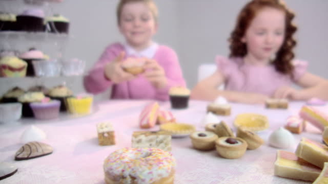 boy and girl eating cakes - cupcake stock videos & royalty-free footage