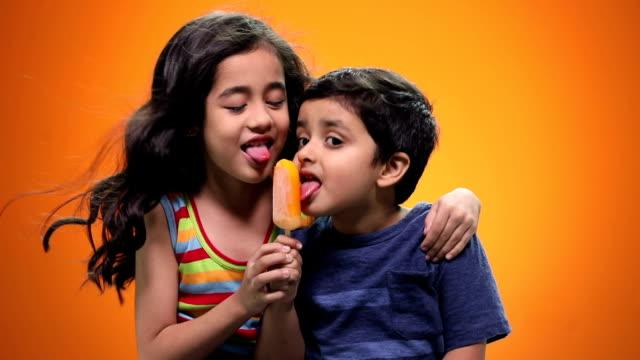 Boy and girl eating ice cream
