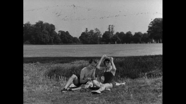 MONTAGE A boy and girl have fun while having a picnic in the country / United Kingdom