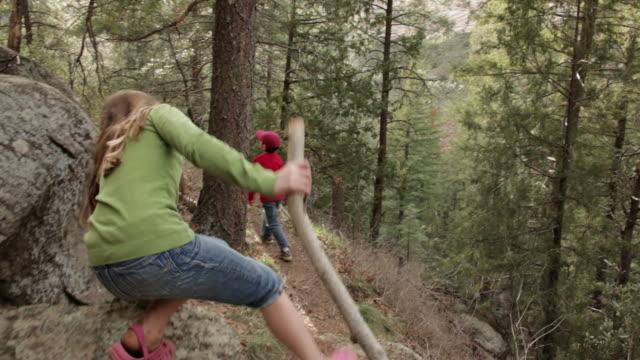 ws pov boy and girl hiking up mountain trail / oak creek, arizona, usa - adventure stock videos & royalty-free footage