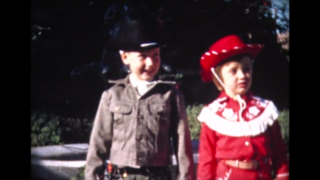 1962 boy and girl in western outfits - cowboy hat stock videos & royalty-free footage