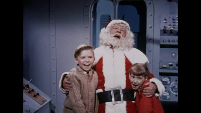 1964 a boy and girl laugh with santa claus - father christmas stock videos and b-roll footage