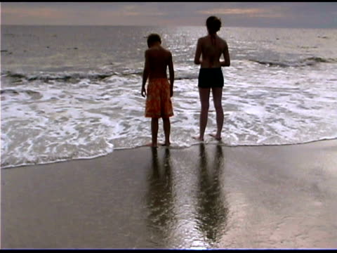 boy and girl on seashore at dusk - see other clips from this shoot 1335 stock videos and b-roll footage
